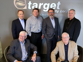 The partners of Target Realty, back row left to right,  Kenyon Chipman, Wayne Berry, Harvey Aronovich and Wayne Hill. Seated: Ralph Gibson, left, and Jim Duggan at their offices on June 3, 2015.