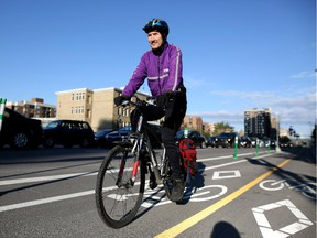 Bill Cozens uses the new cycle tracks on his morning commute to work in Calgary on June 4, 2015.