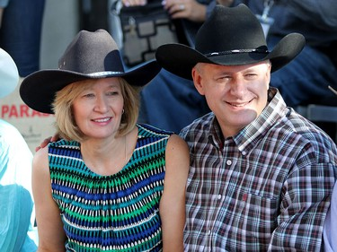 Prime Minister Stephen Harper enjoys the Calgary Stampede parade on July 3, 2015 with his wife Laureen.