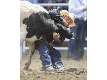K.C. Jones finishes in second place during day three steer wrestling action at the 2015 Calgary Stampede, on July 5, 2015.