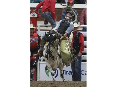 Grady Smeltzer rides his way to a first place finish during day three junior steer riding action at the 2015 Calgary Stampede, on July 5, 2015.