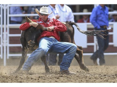 Dru Melvin finishes in seventh place during day three steer wrestling action at the 2015 Calgary Stampede, on July 5, 2015.