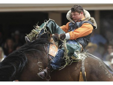 Ryley Borris rides Yoga Release to a first place finish during day three bareback novice rodeo action at the 2015 Calgary Stampede, on July 5, 2015.