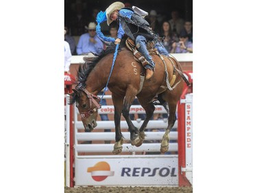 Hunter Sawley rides Yakima Warrior during day three novice saddle bronc rodeo action at the 2015 Calgary Stampede, on July 5, 2015.