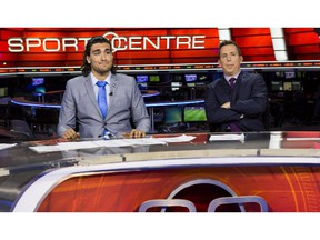 Elias Theodorou, left, shows his frustration during the Road Block at TSN in Toronto alongside broadcaster Scott Duthie during the premiere of Season 3 of The Amazing Race Canada.