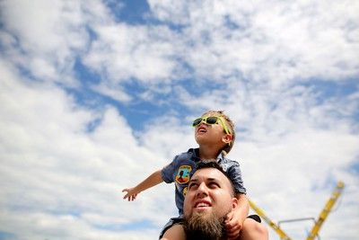 Jeremy Vigini and his son Riley, 4, look to the skies during the Wings Over Springbank air show at Springbank Airport west of Calgary on July 19, 2015.