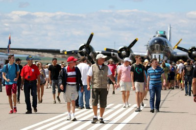 Crowds on the main runway with a WW II b-17 bomber Sentimental Journey in the background during the Wings Over Springbank air show at Springbank Airport west of Calgary on July 19, 2015.