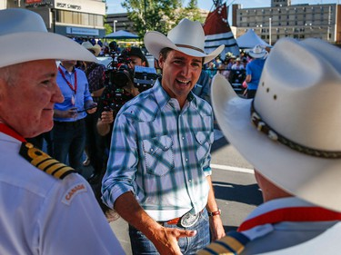 Liberal Leader Justin Trudeau greets spectators during the Calgary Stampede parade in Calgary, Friday, July 3.