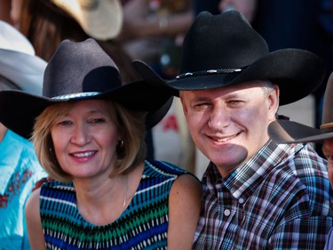 Prime Minister Stephen Harper and his wife Laureen look on during the Calgary Stampede parade in Calgary, Friday, July 3.