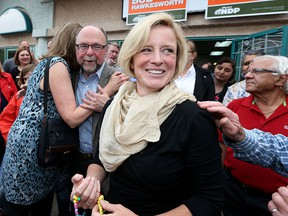 Alberta Premier Rachel Notley is all smiles as she meets NDP supporters at Bob Hawkesworth's campaign office.