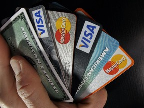 Police have charged four people in connection with an operation that was allegedly using stolen credit card data to manufacture counterfeit cards.