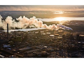 The setting sun reflects off a tailings pond behind Syncrude's oilsands upgrading facility north of Fort McMurray.