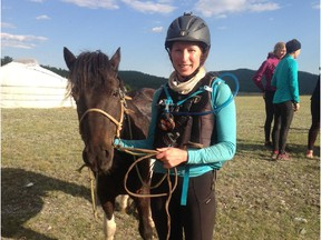 Liz Brown, a former Calgary journalist, crosses the finish line at the Mongol Derby, the world's longest horse race, in August 2015.