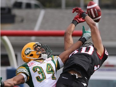 Wide Receiver Eric Rogers misses this pass along with Eskimo Ryan King during first half Labour Day Classic action at McMahon Stadium on Monday September 7, 2015.