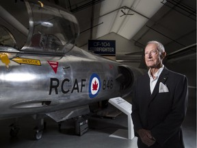Retired major-general Ken Lett stands with a CF-104 Starfighter — a plane he piloted during the Cold War — at an exhibit at the Military Museums marking the four-decade conflict.