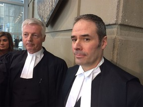 Calgary  Crown prosecutor Lloyd Robertson (right), with Crown Joe Mercier (left) appointed as judge.