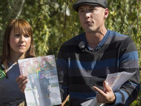 Jesse Rau, supported by his wife Jennifer, left, as he talks to media about his recent dismissal from his Calgary Transit job .