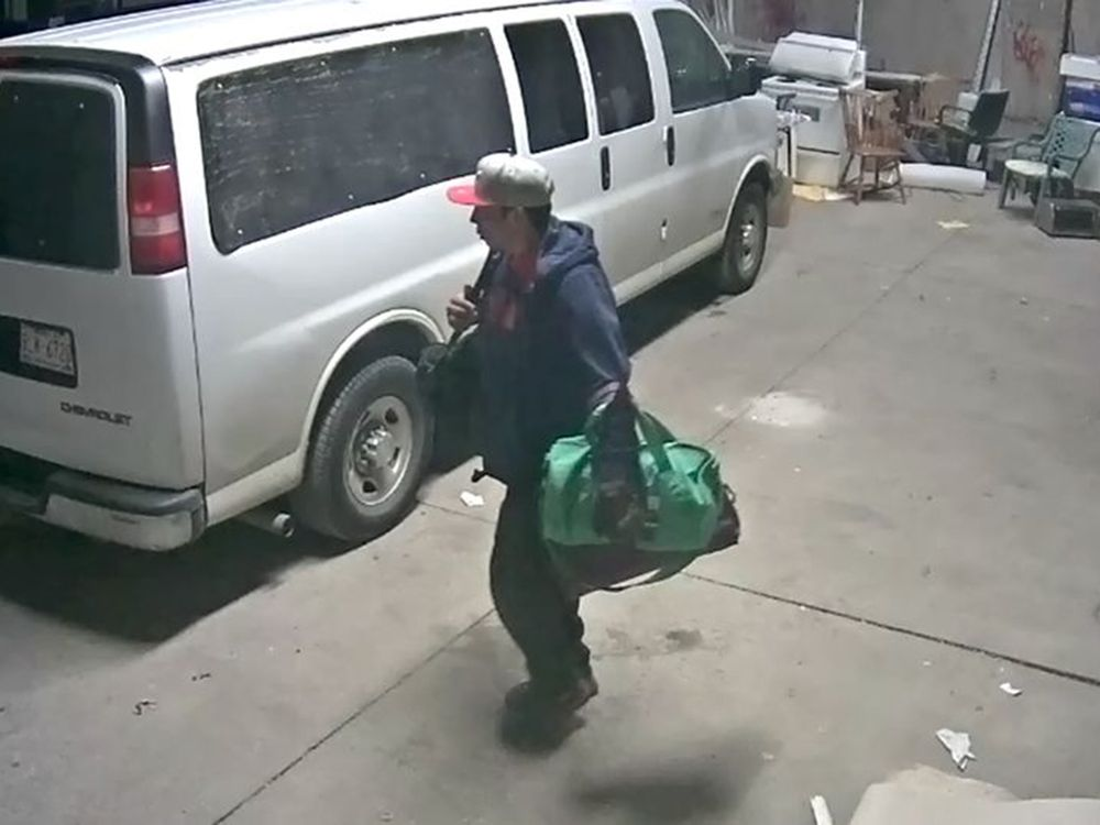 Calgary police released this surveillance image of a man believed responsible for a series of car prowlings int he city.
