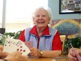 Christina Ryan, Calgary Ruby Friesen plays cribbage with her friends at Silvera for Seniors in Calgary.