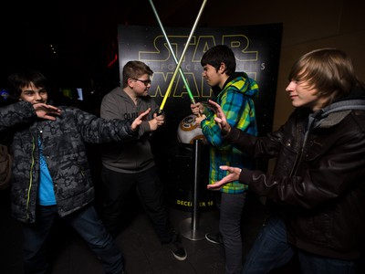 It's light side versus dark side as Leo Mustafa, left, Dominik Kyncl, Jeremy Andrei and Donald Morton pose prior seeing the IMAX showing of Star Wars at Chinook Cineplex in Calgary on Thursday, Dec. 17, 2015.