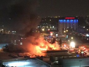 A fire tears through a business in the 9600 block of Macleod Trail the evening of Thursday, December 24, 2015, in Calgary.