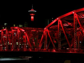 The Langevin Bridge and Calgary Tower are lit red Sunday evening to recognize the National Day of Remembrance and Action on Violence Against Women.