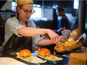 Jessica Pelland, executive chef at Charbar, prepares lunch at the restaurant at the Simmons Building in Calgary.