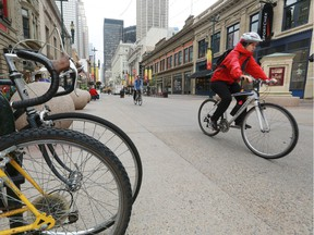Cyclists along Stephen Avenue earlier this summer.