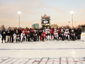 Members of the Stockton Heat pose on the outdoor rink at Raley Field on Thursday. They'll face the Bakersfield Condors on Friday night at Sacramento's baseball stadium.