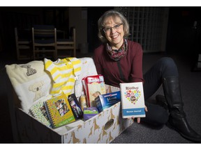 Professor Karen Benzies displays a baby box expectant mothers in Alberta will receive this year as part of a research study called Welcome to Parenthood.