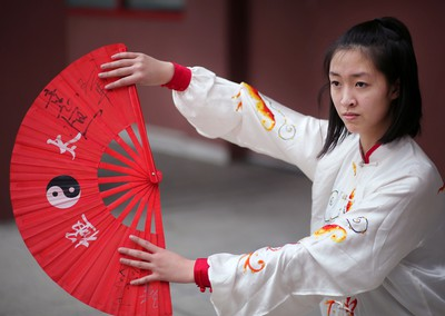 Cheryl Wan, 15, practices her tai chi fan before performing with the Calgary Tai Chi and Martial Arts College during the opening ceremonies of the 2016 Year of the Monkey Chinese New Year Carnival at the Chinese Cultural Centre.