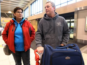 Travellers Sue and Scott Penz say the tanking Canadian dollar won't change their travel plans.