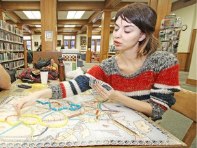 Laura Osburn plays Ticket to Ride during Games Day at the Stratford Public Library on Saturday January 9, 2016. Ticket to Ride is one of the many board games you can play at the newly opened PIPS Board Game Café in Marda Loop.