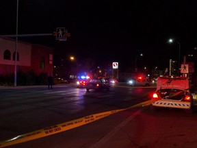 Police close Centre Street North after a pedestrian was hit crossing the thoroughfare on the evening of Monday, Feb. 8, 2016. The woman did not survive.