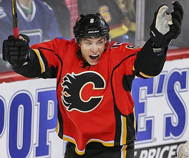 Flames Mark Giordano (L) celebrates his second period goal with teammate Sean Monahan during NHL action between the Carolina Hurricanes and the Calgary Flames in Calgary, Alta. on Wednesday February 3, 2016 at the Scotiabank Saddledome. Jim Wells/Postmedia