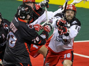 Calgary Roughnecks Mike Carnegie tries to stop a shot by Vancouver Stealth Jordan Durston in NLL action at the Scotiabank Saddledome in Calgary, Alta. on Saturday January 30, 2016. Mike Drew/Postmedia