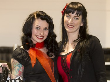 Kacie Phillips (L) poses for a photo with  organizer Debbie Shipley after winning the Pin-Up Girl Contest during the World of Wheels show at the BMO Centre in Calgary, Alta., on Sunday, Feb. 21, 2016. The popular auto-enthusiast show was in its 50th year. Lyle Aspinall/Postmedia Network
