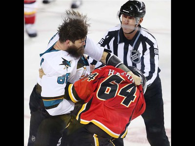 San Jose Sharks Brent Burns fights Garnet Hathaway of the Calgary Flames during NHL hockey in Calgary, Alta., on Monday, March 7, 2016. AL CHAREST/POSTMEDIA