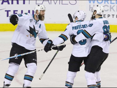San Jose Sharks, left to right, Joe Thornton, Joe Pavelski and Brent Burns celebrate the winning goal in overtime against the Calgary Flames in NHL hockey action at the Scotiabank Saddledome in Calgary, Alta. on Monday March 7, 2016. The Flames lost to the Sharks 2-1 in OT. Mike Drew/Postmedia