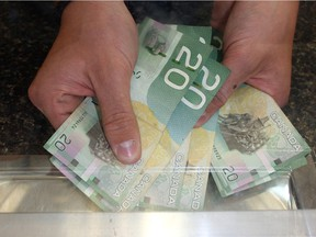 Currently in Alberta, cash stores are allowed to charge $23 for every $100 a customer borrows, to a maximum of $1,500.