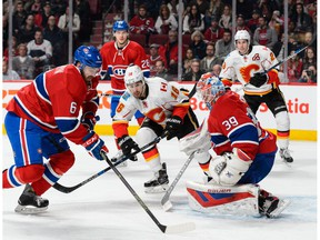 MONTREAL, QC - MARCH 20:  Greg Pateryn #6 of the Montreal Canadiens picks up a rebound left by goaltender Mike Condon #39 during the NHL game against the Calgary Flames at the Bell Centre on March 20, 2016 in Montreal, Quebec, Canada.