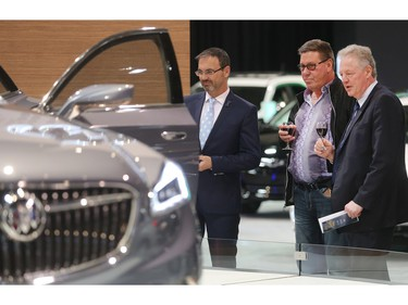 From the left, Dan Broderick, Paul Peters and Glenn Lemmerick admire a Buick Avenir at the Vehicles and Violins Gala Tuesday night March 8, 2016 at the BMO Centre. Sponsored by the Calgary Motor Dealers Association, the gala is in it's 17th year. This year's beneficiaries are Fresh Start Recovery Centre, The Alex and Children's Cottage Society. (Ted Rhodes/Postmedia)