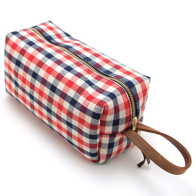 King me This kit bag is perfect for shaving supplies, knick-knacks and all those little things you pick up on your travels. It comes in a variety of patterns, but we're partial to this stand-out gingham check that will be easy to find in your suitcase. $88 at North American Quality Purveyors, 1207 10th Ave. S.E., 403-910-9913, shopnorthamerican.com.