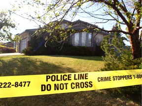 Calgary Police investigate at a home on Woodridge Close SW in Calgary, Alta on Wednesday April 27, 2016. Police were called around 3 a.m. to the home to respond to reports of a woman in medical distress. Officers found Melissa Couture, 38, of Calgary, unresponsive in the home and pronounced her dead.