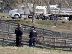 Police search an acreage on Range Road 291 east of Airdrie as part of a stolen property investigation on Tuesday April 12, 2016.