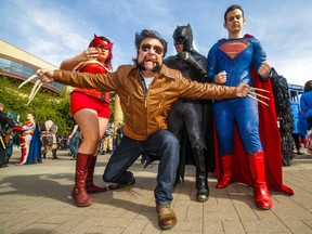 The Scarlet Witch (Jen Rey), Batman (Franz Miguel), Superman (Peter Fourlaris) and a snarling Wolverine (Dale Kliparchuk) at the annual Parade of Wonders that kicks off the Calgary Comic & Entertainment Expo at the BMO Centre in Calgary, Ab., on Friday April 29, 2016. Mike Drew/Postmedia