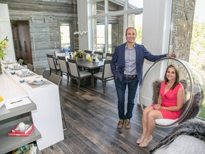 Mark Kwasnicki and Dawn Lavergne at the McKinley Masters' show home in Silverhorn with the bubble chair that inspired it all.