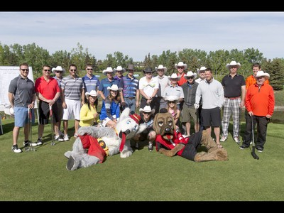 Competitors mug for a photo before the start of the Shaw Charity Classic's annual Shootout at the Meadows at Canyon Meadows Golf and Country Club in Calgary, Alta., on Wednesday, May 18, 2016. The celebrity-and-media closest-to-the-pin driving contest is a precursor to the Shaw Charity Classic golf tournament set to begin Aug. 31. Lyle Aspinall/Postmedia Network