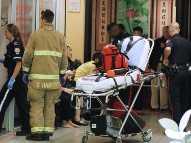 Police and emergency workers deal with a stabbing incident in the Perpetual Wellness Chinese Medicine Centre on Thursday June 16, 2016