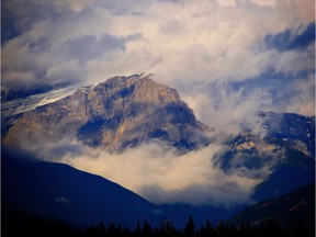A storm rolls in over the mountains in Kananaskis Country.